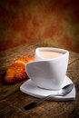 Italian breakfast with milk coffee and croissant Royalty Free Stock Image