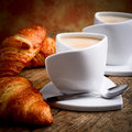 Italian breakfast with milk coffee and croissant Stock Photo