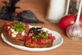 Italian bruschetta with tomatoes and feta toasted bread drenched in olive oil served Stock Photos