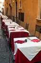 Italian cafe street row of tables by the wall in a narrow street Royalty Free Stock Image