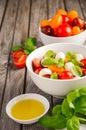 Italian Caprese salad with cherry tomatoes, small mozzarella and fresh basil Royalty Free Stock Photo
