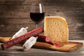 Italian cheese and salami with glass of red wine Stock Image