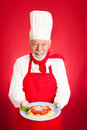Italian chef spaghetti marinara handsome cooks red background Royalty Free Stock Image