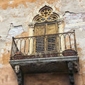 Italian classic neglected balcony in verona with peeled plaster rendering Stock Photography