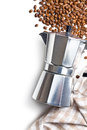 Italian coffee maker top view of with beans and napkin Stock Images