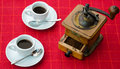 Italian coffee special composition with cups and antique grinder Royalty Free Stock Images