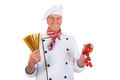 Italian cook with pasta and tomatoes holding mixed colorful spaghetti Stock Images