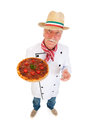 Italian cook with pizza holding in wide angle Royalty Free Stock Images