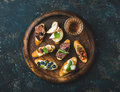 Italian crostini and glass of wine on round serving tray Royalty Free Stock Photo