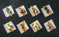 Italian crostini with various toppings on white baking paper Royalty Free Stock Photo