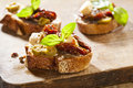 Italian cuisine appetizer bruschetta tomatoes olives cheese Stock Photos