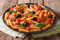 Italian cuisine: pasta penne with meatballs, olives and tomatoes Royalty Free Stock Photo
