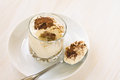 Italian dessert tiramisu in a glass on white background Stock Photo