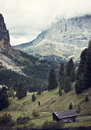 Italian dolomites a view on and a small mountain cabin Royalty Free Stock Photo
