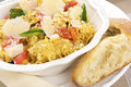 Italian egg noodles with oil and cheese plate of tomato basil black pepper parmigiano reggiano olive crusty bread Stock Photography
