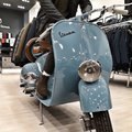 Italian famous scooter in a dress shop. Royalty Free Stock Photo