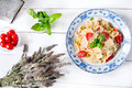 Italian fettuccine pasta with cherry tomatoes and parmesan Royalty Free Stock Photo