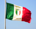 Italian flag front blue sky Stock Images