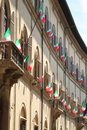 Italian flags outside of a windows Stock Photography