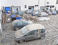Italian floods aftermath and cleanup, damaged cars Stock Images