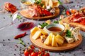 Italian food. Assortment of appetizers for a large company in a restaurant. Different types of smoked meat, sausages and cheeses.