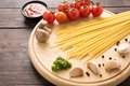 Italian food background, with tomato, garlic, pepper, spaghetti Royalty Free Stock Photo