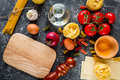 Italian food concept pasta ingredients on grey stone desk background top view mock up