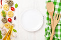 Italian food cooking ingredients and empty plate Royalty Free Stock Photo