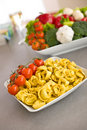 Italian food - pasta, tomato, ingredients for cook Stock Photography