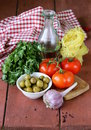 Italian food still life - pasta, olive oil, tomatoes Royalty Free Stock Photo
