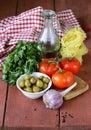 Italian food still life - pasta, olive oil, tomatoes Royalty Free Stock Photo
