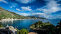 Italian harbour with beautiful sky above and clear blue water Royalty Free Stock Photography