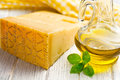 Italian hard cheese with basil and olive oil Stock Photo