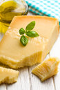Italian hard cheese with basil and olive oil Royalty Free Stock Photos
