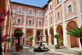 Italian house and courtyard with plants fountain Stock Image
