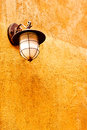 Italian lamp on orange wall Royalty Free Stock Photo