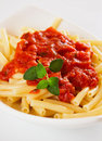 Italian macaroni pasta with tomato sauce Stock Photos