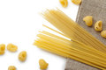 Italian macaroni shells and spaghetti with rope on brown bagging Royalty Free Stock Photo