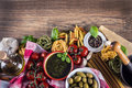 Italian and mediterranean food ingredients on old wooden background spaghetti olives basil tomato pesto pasta garlic pepper olive Royalty Free Stock Images