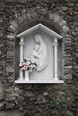 Italian memorial white madonna and child relief in cinque terre italy Stock Image