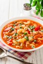 Italian minestrone soup on white wooden background. Royalty Free Stock Photo