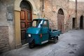 Italian old car umbria vintage three wheels in a typical stone village of italy Stock Photo