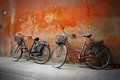 Italian old style bicycles against an wall Stock Photos