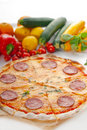 Italian original thin crust  pepperoni pizza Royalty Free Stock Image