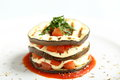 Italian parmigiana dish aubergines mozarella tomato sauce basil white background Stock Photo