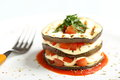 Italian parmigiana dish aubergines mozarella tomato sauce basil white background Stock Photos