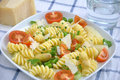 Italian pasta with asparagus and tomatoes Royalty Free Stock Photo