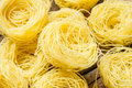 Italian pasta capelli di angelo nests Royalty Free Stock Photo