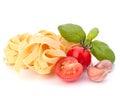 Italian pasta fettuccine nest  and cherry tomato Royalty Free Stock Photo