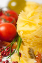 Italian pasta, fresh tomatoes, fragrant pepper and Royalty Free Stock Image